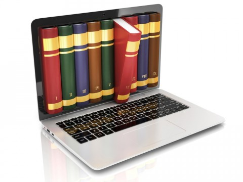 Stock image of a laptop with pictures of books